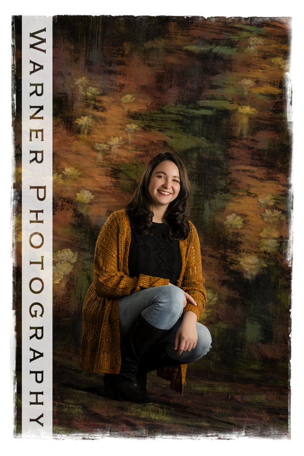 A studio portrait of Dow High senior Lily with brown tones