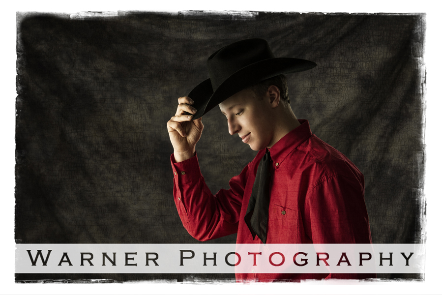 Studio portrait of Dow High School senior Tommy with his black cowboy hat and red shirt