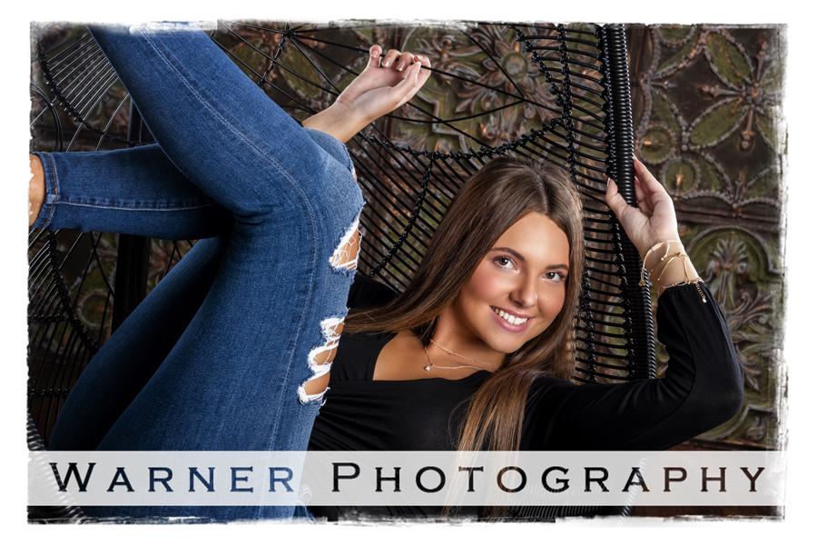 Senior portrait of Dow High School senior Alexis in a chair at Warner Studio