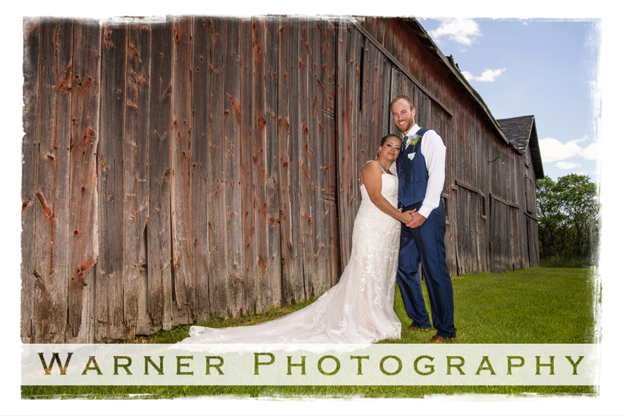 Wedding portrait of Nicole and Ryan outdoor by a barn on private property