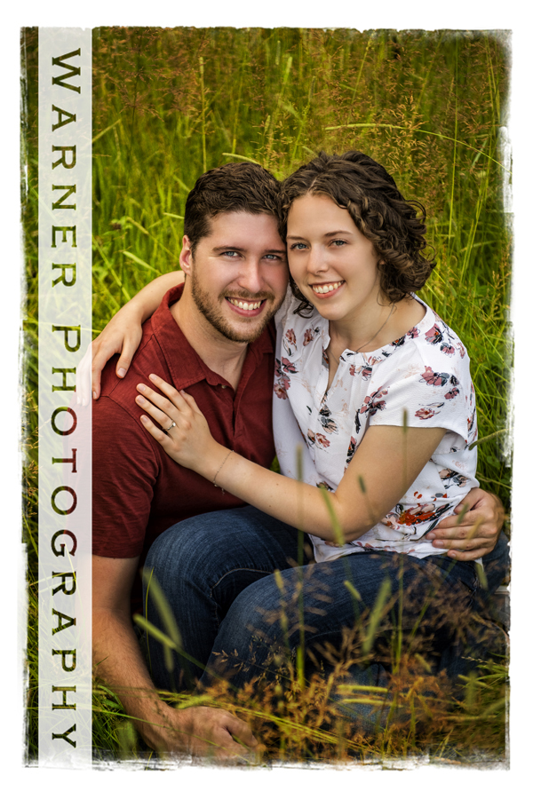 Outdoor engagement portrait of the newly engaged couple
