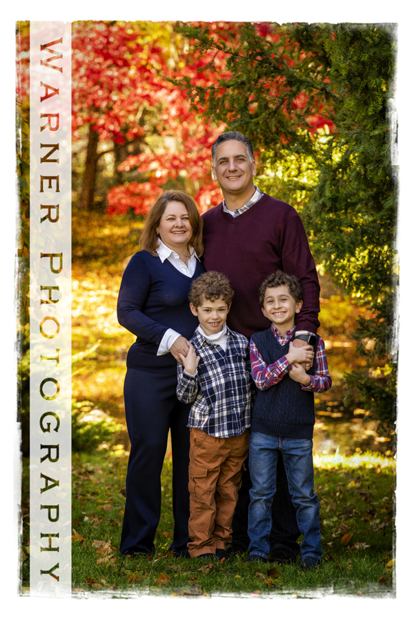An outdoor portrait of the Rapanos family at Dow Gardens with the fall leaves