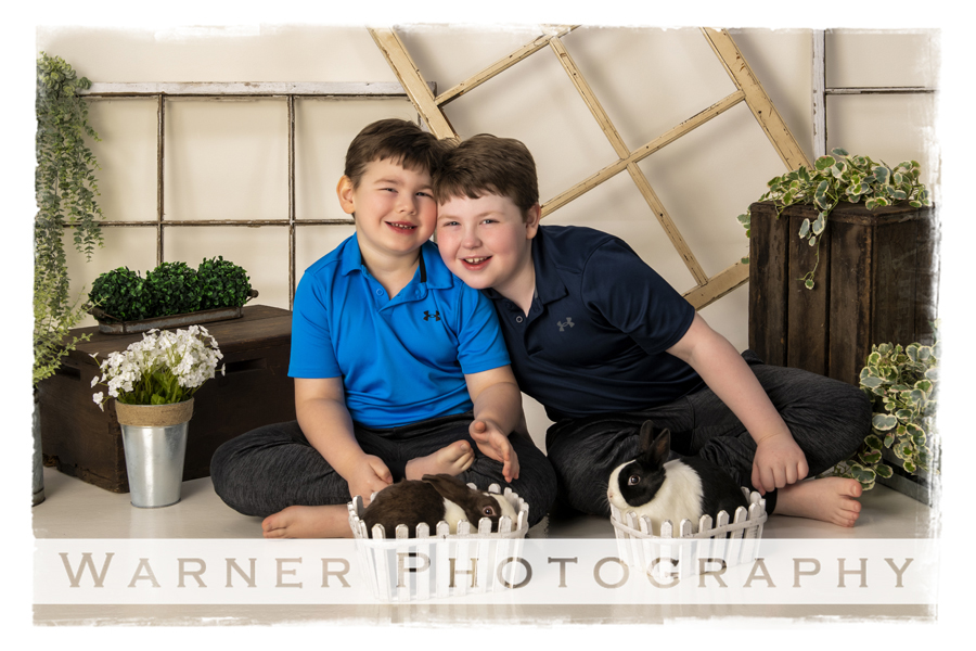 a portrait of Brady and Carson at the studio with bunnies