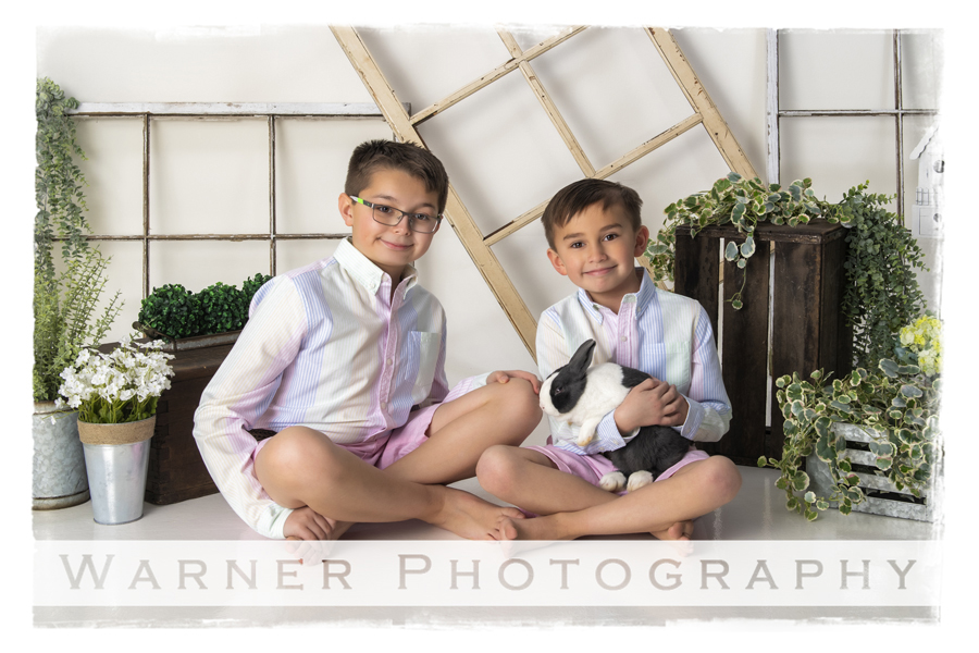 A studio portrait of Ian and Anson for their Easter session with the bunnies