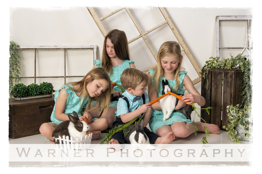 a studio portrait of the Murtha children for their easter session with the bunnies