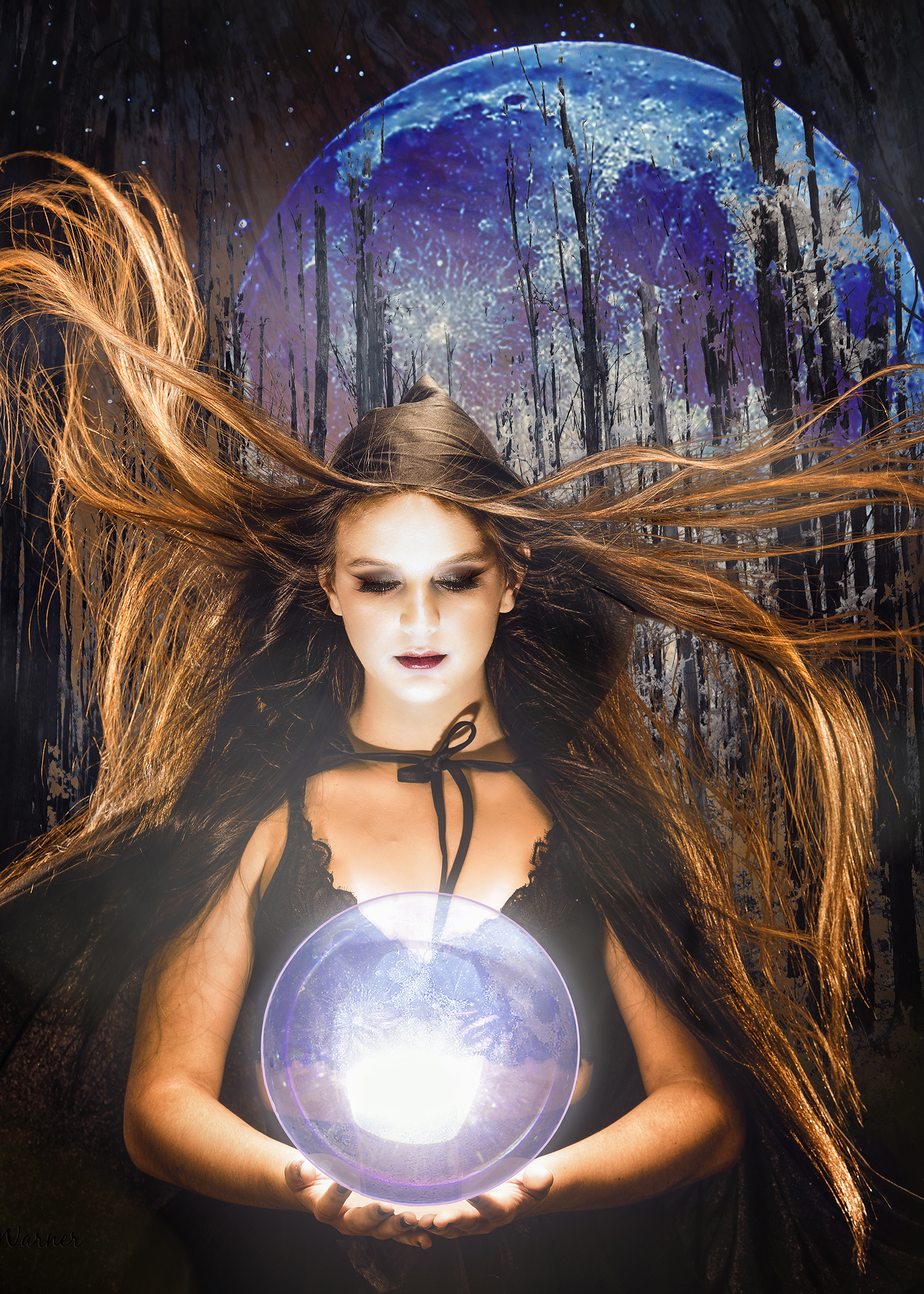 an artistic portrait of Taylin at the studio with a cape and crystal ball
