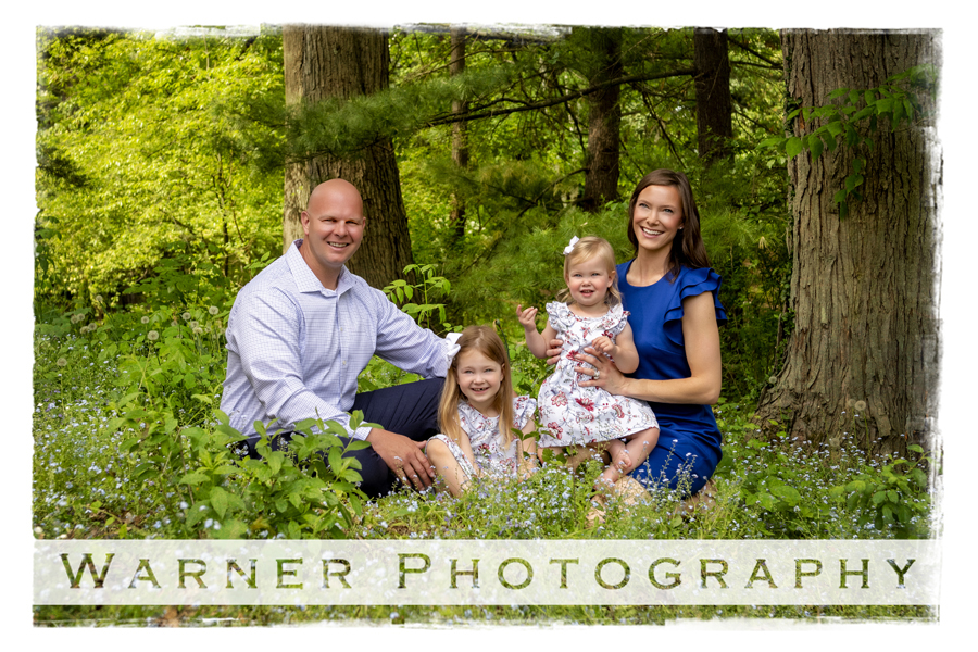an outdoor portrait of the Briston family at Dow Gardens