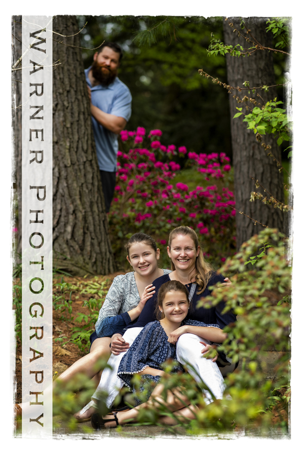 an outdoor family portrait of the Lepley family at dow gardens