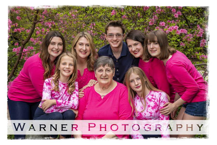 an outdoor portrait of the Renken family at Dow Gardens with pink flowers