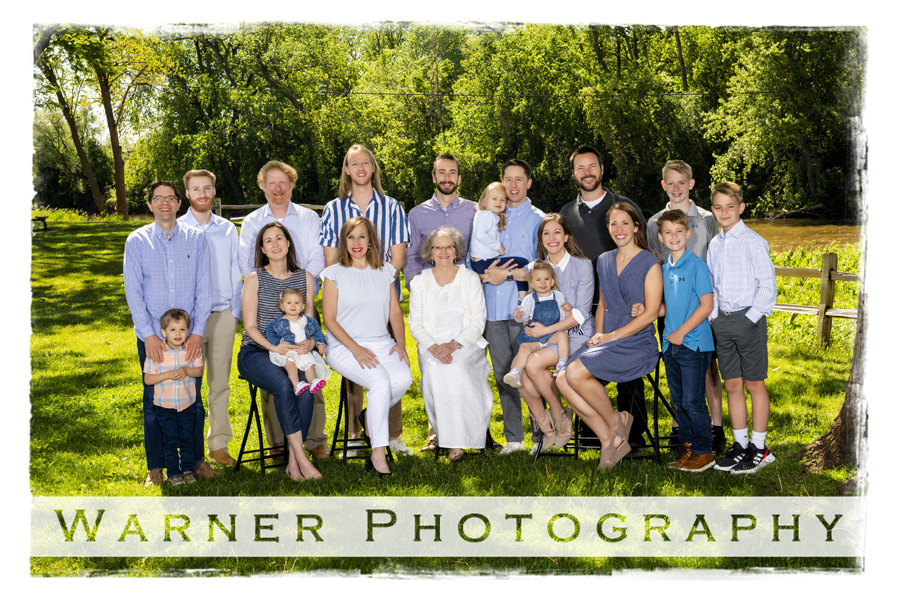 an outdoor portrait of the Pammler family near the tridge in Downtown Midland