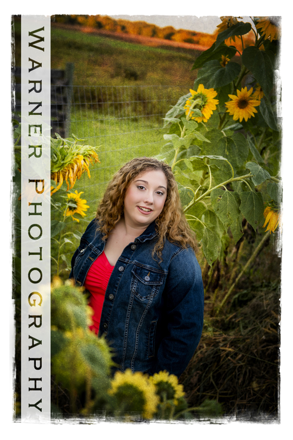 An outdoor portrait of Clare High School senior Amaris at the Chippewa Nature Center